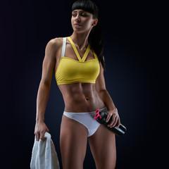 Woman bodybuilder resting