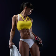 Fitness female model holding protein shake