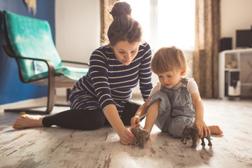 young pregnant mother and son playing on floor, lifestyle, Wall mural