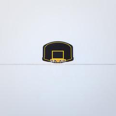 Basketball rim on black backboard.