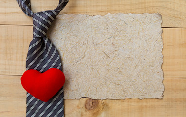 Father's day concept background, necktie and red heart on natural texture paper