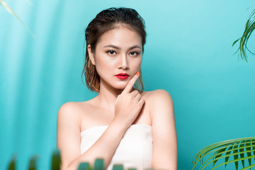Tropical summer holiday fashion beauty concept. Summer style portrait of young attractive asian woman.