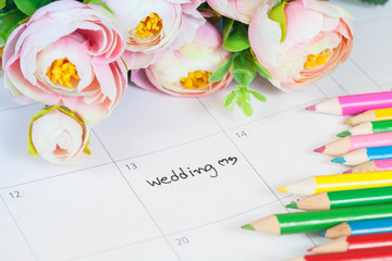 word wedding on calendar with sweet flowers and pen  ,love conce