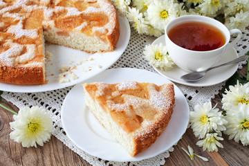 Delicious apple pie and tea on old blackboard