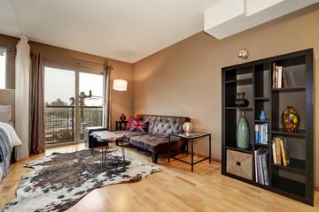 Brown walls bedroom interior with cozy sitting area