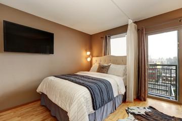 Brown walls bedroom interior in apartment.