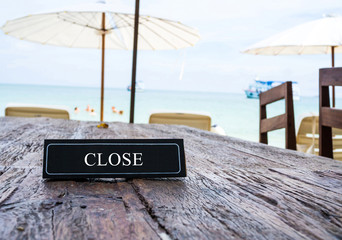 Close banner on restaurant table, beach background
