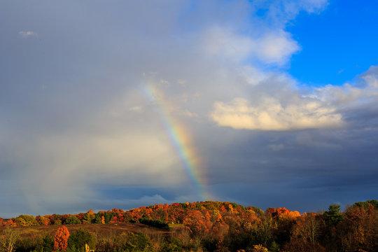 Rainbow over autumn hillside in Berkshires Hudson Valley NY