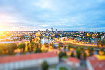 Fototapete - Vilnius cityscape view from the castle hill during the sunset in Lithuania. Wide angle photo with tilt-shift technic