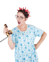Screaming funny housewife with old telephone