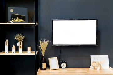 Modern wood shelf with flat TV in living room at home.