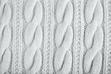 Knitted jersey background with a relief pattern