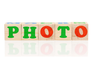 Photo word formed by colorful wooden alphabet blocks, isolated on white background