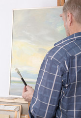 An artist painting in studio. Selective focus