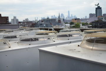 Cooling Units on Roof with City in the Background