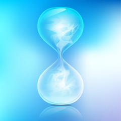 True transparent sand hourglass on bule background; Simple and elegant sand-glass timer; abstract science; smoke in sand hourglass refers to emptiness