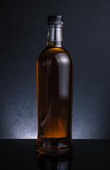 whiskey bottle on black background, cool atmosphere