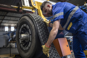 Tire repairer applying tire tread
