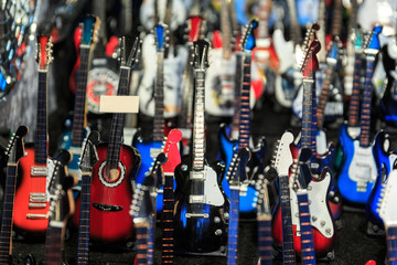 Colorful close up details of christmas fair market. Guitar on the arm decorations for sales