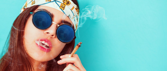 Hippie girl portrait smoking and wearing sunglasses letterbox
