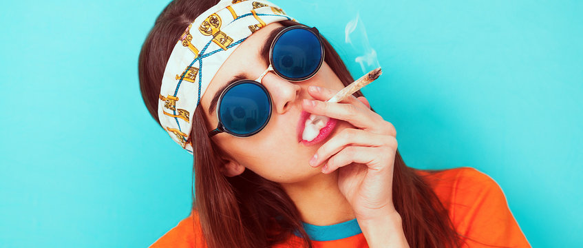 Hippy girl portrait smoking weed and wearing sunglasses letterbox