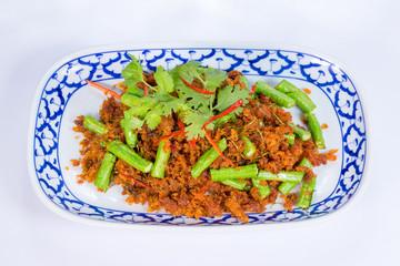Stir fried crispy pork belly and red curry..