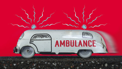 Ambulance vintage toy car on red background