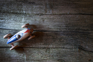 Vintage toy car on on wooden background