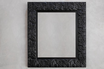 Black leaf picture frame with gray background.