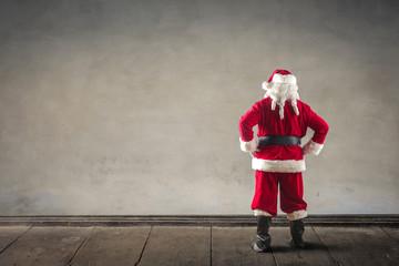 Santa Claus staring at a blank wall