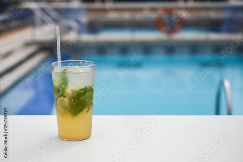 "Sparkling mint lemonade at swimming pool."" Stock photo and royalty ..."
