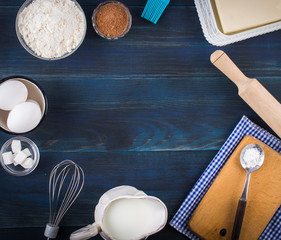 Ingredients for the dough. On blue, wooden background.Top view. Flat lay.