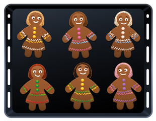 Gingerbread women on baking plate - cute and sweet christmas cookies.
