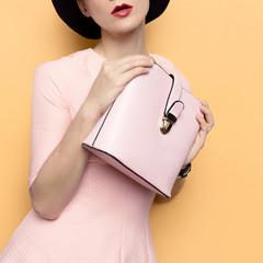 Model in a stylish retro hat and accessory bag. Love Retro Style