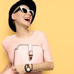 Happy Lady Coco stylish retro hat and sunglasses. Bag. Love Vint