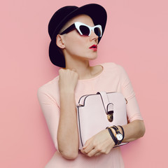 Lady Charm in retro hats and fashion accessories. Eyeglasses and