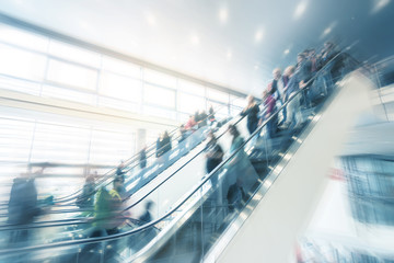 trade fair escalator with blurred people
