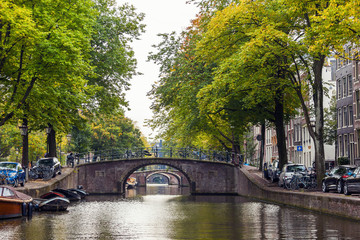 Arched bridges stretching into the distance in Amsterdam