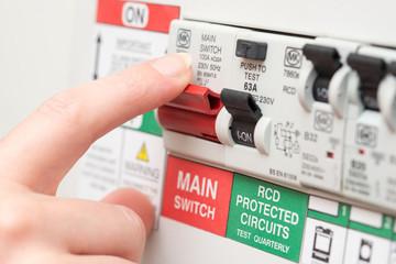 Finger on MAIN Switch on RCD Circuit Breaker Board