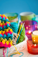 The white basket crochet fabric and colored yarn.