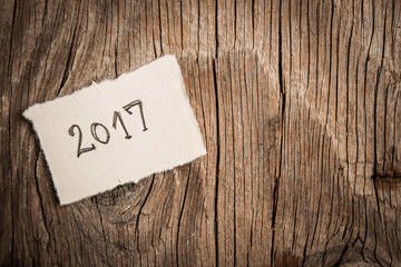 Happy New Yera 2017 on rustic wooden background