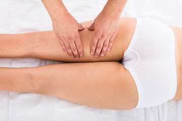 Woman Receiving Leg Massage In Beauty Spa