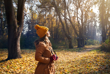 Woman with camera at autumn park