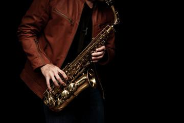 Keuken foto achterwand Muziek Jazz saxophone musician in the leather jacket, closeup.