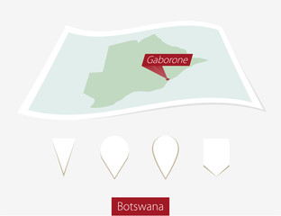Curved paper map of Botswana with capital Gaborone on Gray Background. Four different Map pin set. Vector Illustration.