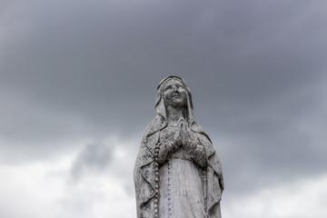 Virgin Mary stone statue