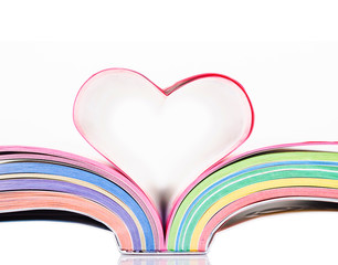 Opened book with sheets in the form of heart.