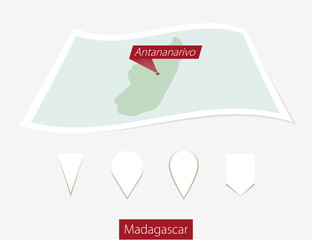 Curved paper map of Madagascar with capital Antananarivo on Gray Background. Four different Map pin set. Vector Illustration.