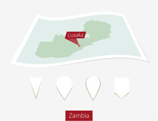 Curved paper map of Zambia with capital Lusaka on Gray Background. Four different Map pin set. Vector Illustration.