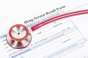 Drug test blank form with stethoscope.
